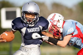 It's Not Just About Concussions: New Study Links Youth Football Leads to Later Behavioral Problems